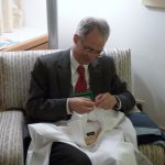 Help needed! My deputy repairing my shirt at the General Assembly of the World Council of Churches in Busan, Korea (2013)