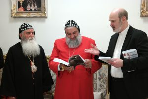 Thomas Schirrmacher presenting a number of books to Patriarch Ignatius Aphrem II, among them a comprehensive work by the WEA on the topic of Christian persecution