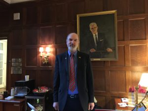 Thomas Schirrmacher under the portrait of Cornelius van Til in the entrance hall of Westminster Theological Seminary