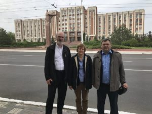 The Schirrmachers and their host in front of the Parliament in Tiraspol © private